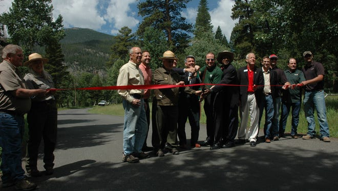 """Rocky Mountain National Park's popular Old Fall River Road reopened Thursday, marking a """"significant milestone"""" in flood recovery just in time for the busy holiday weekend."""