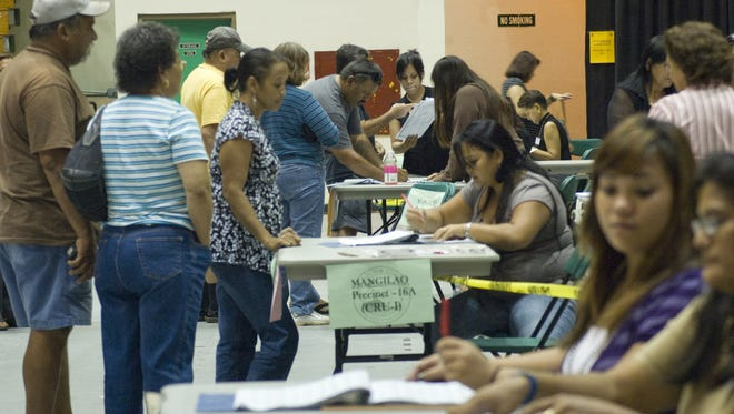 Guam residents during the 2008 General Election line up to vote at the University of Guam Field House.