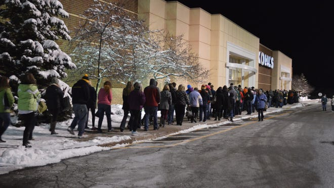 Shoppers start toward the doors at Kohl's in Rib Mountain moments after the store opened at 6 p.m. on Thanksgiving 2014.