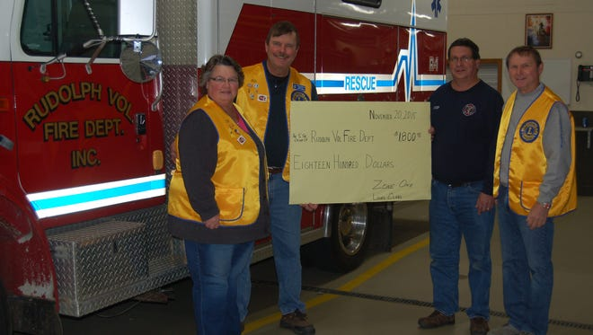 Pictured are Trish Homann, Lion; Larry Homann, president of the Rudolph Lions; Rudolph Fire Chief Tony Konkol; and Gary Erickson, secretary/treasurer of the Rudolph Lions.