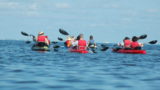 Participants take part in a kayaking tour from Manatee Cove Park on Merritt Island that is organized and led by led by FunDay Tours. A Day Away Kayak Tours is the outfitter for those tours.