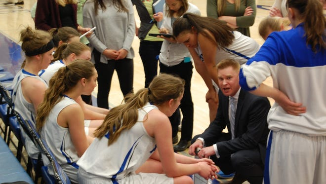 Poudre girls basketball coach Curtis Glesmann strategizes with the team during a timeout in a Tuesday, March 1, 2016 playoff game against Cherry Creek at Poudre High School. The Impalas lost, ending their season.