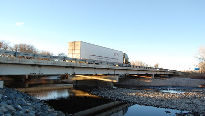 A semi travels over the bridge spanning the Poudre River along Interstate 25 near Fort Collins last year. Local groups are making another round of federal grant applications to replace several I-25 bridges, and, they hope, pave the way for an extra lane.