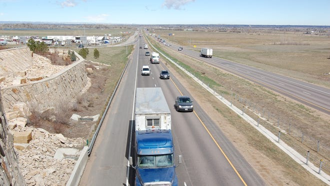 Traffic passes under the Interstate 25 overpass for Colorado Highway 392 outside of Windsor on Thursday