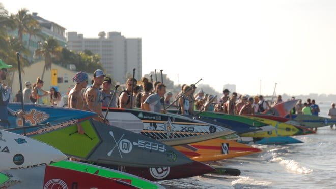 Racers line up for the 2015 Battle on the Blueway Stand Up Paddleboard races at Fort Myers Beach.
