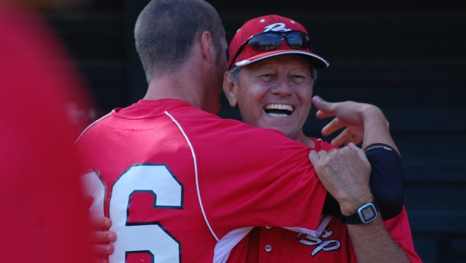 Palm Springs Power manager Harry Gurley is congratulated by designated hitter Sean Flanagan after the Power defeated the SoCal Athletics 11-1 to win the SCCBL title in this 2011 file photo.