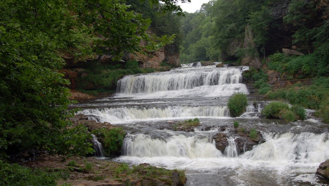 Cascading over limestone cliffs, Willow Falls is one of the main attractions at Willow River State Park near Hudson.