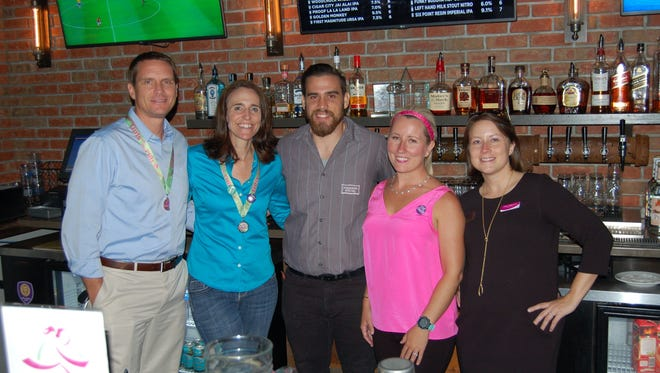 Guest bartenders at the Girls On The Run benefit at Madison Social.