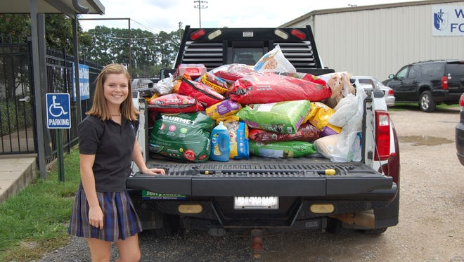 St. Frederick High School collected a truck load of pet food and supplies to donate to the flood victims in South Louisiana.