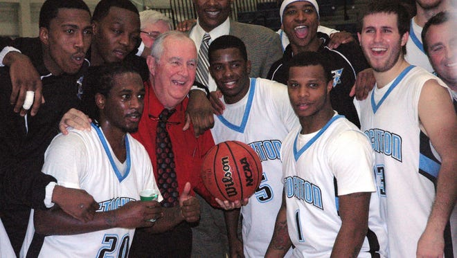 Gerry Matthews with his players in 2012, as he closed in on Pete Carril's record for most wins by a New Jersey college men's basketball coach.