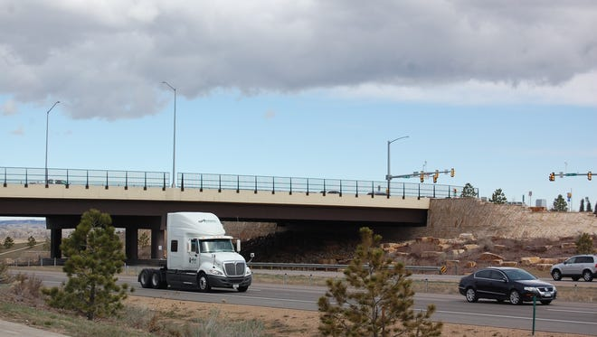 Traffic passes under the Interstate 25 overpass for Colorado Highway 392 outside of Windsor in this file photo. The Larimer County Commission formally accepted the agreement Tuesday to pool the taxes from area municipalities to help pay for expansion of the interstate.