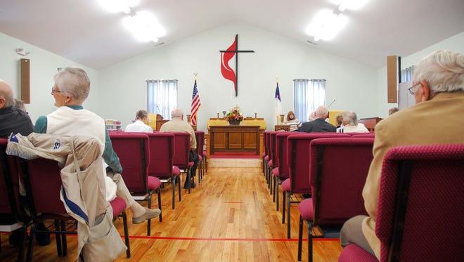 Church-goers await a service at Mount Pleasant United Methodist Church on Sunday, Nov. 11, 2016.