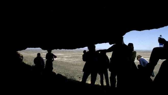 Photo from 2006: Fernley teachers and students stand at the mouth to Spirit Cave.