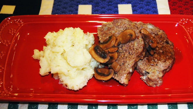 Savory Rosemary Meatloaf with mashed potatoes.