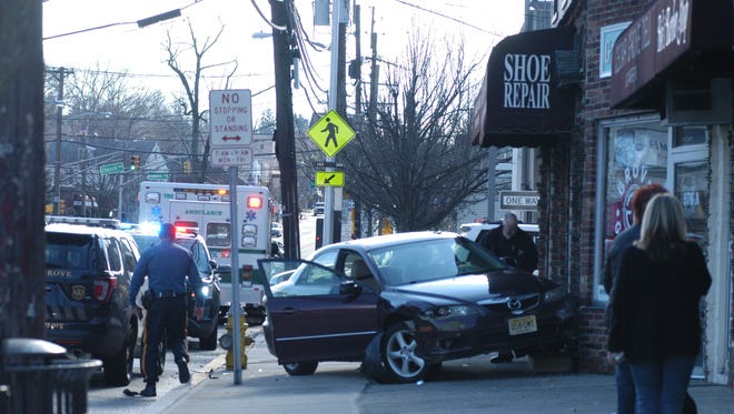 A car collided with a building on Pompton Avenue in Cedar Grove Thursday afternoon, Jan. 26, 2017.