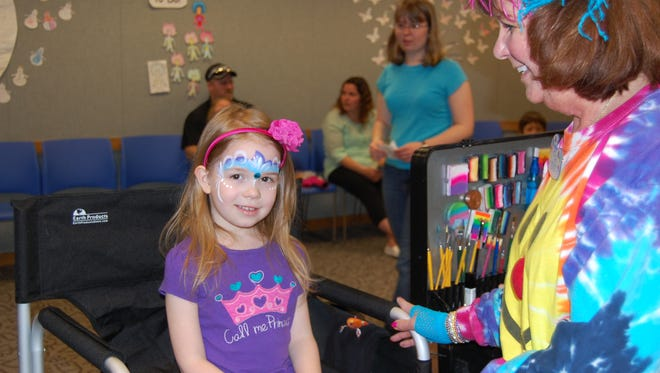 Kids can enjoy free face painting and balloon animals during WinterGreen, held March 18 at Mead Public Library.