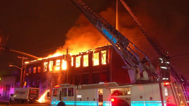 A three-alarm fire tore through an abandoned school on Bergen Street Monday morning.