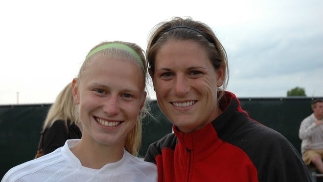 Marlee Buss, left, with Kimberly High School girls' soccer coach Kristin Ruhsam-Tegelman.