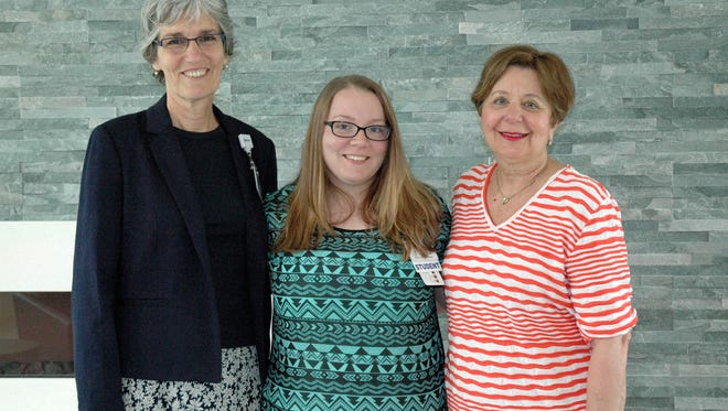 Shown (left to right) are Diane Barlow, Gift Planning Officer with Beebe Medical Foundation; Charmaine Ferebee, recipient of the Mildred Gray scholarship; and VIA President Rose Marie Patin.