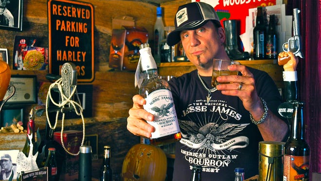 Jesse James Dupree wields a wicked chain saw at night and pitches his own brand of spirits during the day. He will sign autographs June 24 at Barnett Harley-Davidson ahead of his band Jackyl's performance at the El Paso Downtown Street Festival.
