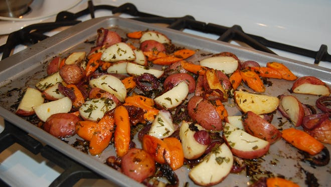 Herb-roasted potatoes and carrots
