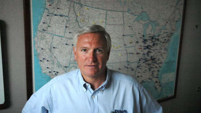 FILE - Pilot Travel Centers CEO Jimmy Haslam stands in front of a map showing where each of the company's travel centers are located on Oct. 16, 2006.