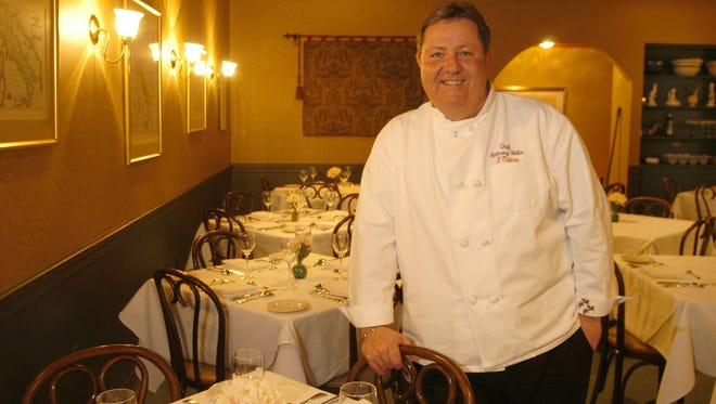 In this 2004 photo, Chef-owner Anthony Stella poses in the middle of the dining room of L'Osteria, where he served  homemade pasta based on old family recipes.