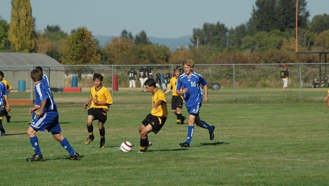 Western Mennonite's boys soccer team plays.