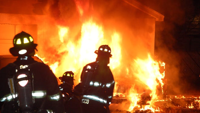 A car caught fire early Monday morning, damaging a nearby car and a garage in Lodi.
