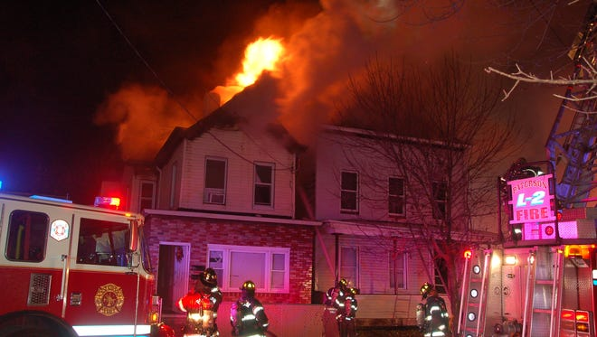 A three-alarm fire broke out in Paterson Sunday night, displacing 10 people.