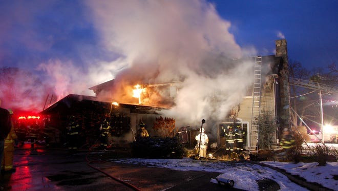 Firefighters battle a blaze at a home on Airmont Avenue in Mahwah.