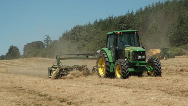 Farm equipment starts the harvest season at a Doerfler Farms field in Marion County in this file photo.