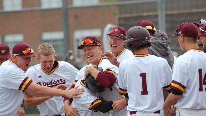 Windsor players celebrate tying Greeley Central in the bottom of the eighth in regional action last weekend. The Wizards escaped with a 2-1, nine-inning win.