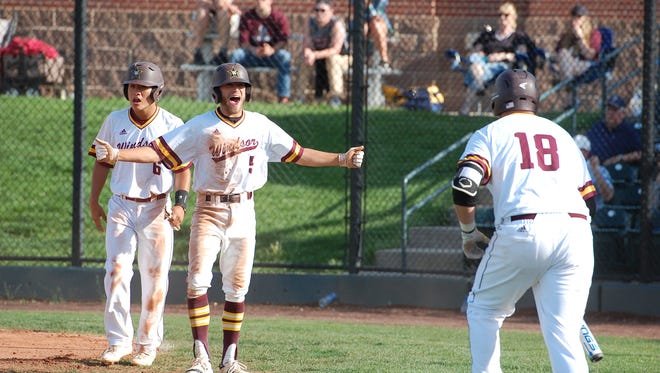 Windsor's Josh Barker celebrates scoring a run during the Wizards' 4A state baseball tournament game against Cheyenne Mountain on Tuesday at All-Star Park in Lakewood.