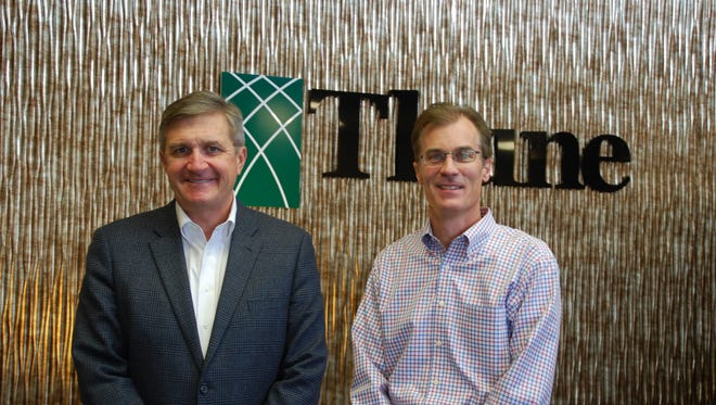 Pat McCann (left), chief executive officer of North Risk  Partners, meets with Mark Thune, president of Thune Insurance Network. The companies recently merged.