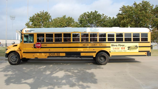 Lumber Liquidators advertisement on a Dallas County School bus.