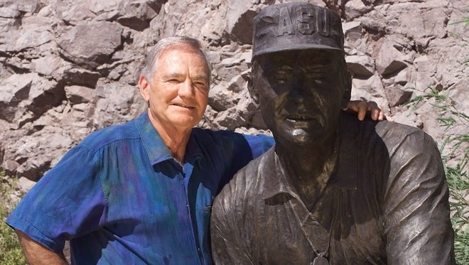 Frank Kush poses next to his statue at Sun Devil Stadium. The field was renamed in his honor during the 1996 season.