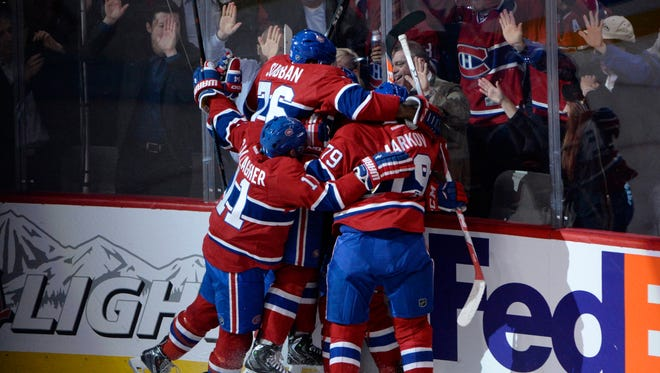 Apr 15, 2015; Montreal, Quebec, CAN; Montreal Canadiens forward Tomas Plekanec (14) reacts with teammates including P.K. Subban (76) and Brendan Gallagher (11) after scoring a goal against the Ottawa Senators during the second period in game one of the first round of the the 2015 Stanley Cup Playoffs at the Bell Centre. Mandatory Credit: Eric Bolte-USA TODAY Sports