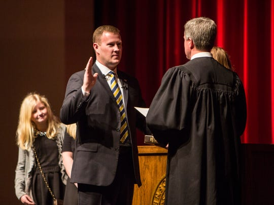 Chad McBride takes the oath of office Thursday for the Anderson County sheriff's post.