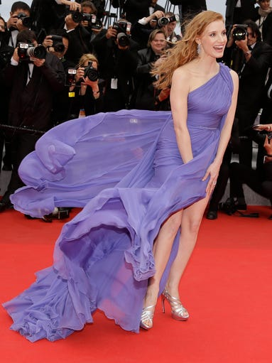 "Jessica Chastain does a lovely job suppressing the wind's effect on her dress at the screening of ""Foxcatcher"" on May 19 at the International Cannes Film Festival, in southern France."