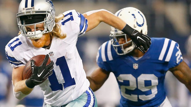 Dallas Cowboys' Cole Beasley catches a Tony Romo pass for a touchdown against the Indianapolis Colts.