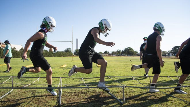 Ropes' football team runs drills during the first day of fall practices on Aug. 3 in Ropesville. The Eagles are set to play their first 11-man home game of the millennium against Odessa Compass Academy at 7 p.m. Thursday.