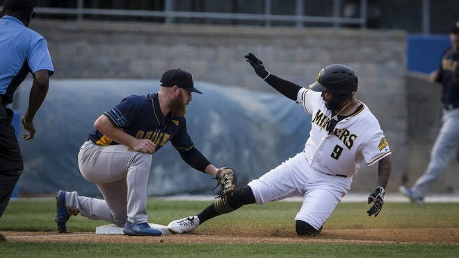 Sussex County's Cito Culver, right, is safe sliding into third base as Quebec's Jesse Hodges guards the base during a contest during the 2019 Can-Am League season. Culver is leading the All American Baseball Challenge with a .424 average for the first-place Miners entering Saturday' actions.