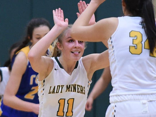 Manogue's Kenna Holt celebrates against Reed with teammate