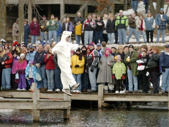 A man jumps at the Polar Bear Jump at the Lure Bar
