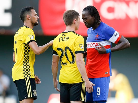 Columbus Crew midfielder Will Trapp (20) and FC Cincinnati Djiby Fall (9) square up after Trapp shoved Fall over the ball in the first half of the US Open Cup soccer match between FC Cincinnati and Columbus Crew at Nippert Stadium in Cincinnati on Wednesday, June 14, 2017. At the end of the first half the game was tied at 0.