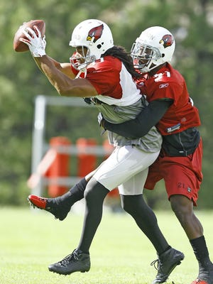Larry Fitzgerald and Patrick Peterson face each other in training camp in Flagstaff in 2011, Peterson's rookie season.