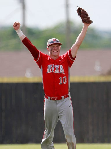 Nixa Eagles short stop Jacob Karlson celebrates after making the last out to beat the Willard Tigers in class 5 sectionals at Willard High School on Wednesday, May 28, 2014.