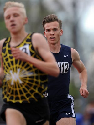 Granville's Joe Pappas races just behind Watkins Memorial's Andrew Jordan during the final leg of 4x1,600 relay this past Friday during the Fulton Relays at Lancaster.