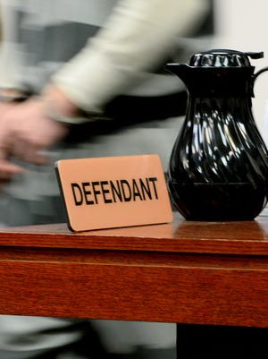 A defendant walks into the courtroom in Ingham County Circuit Court in this LSJ file photo.